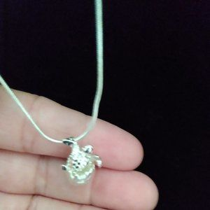 Silver chain with turtle hatching.